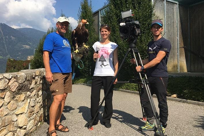 Editor Birgit, cameraman  Michi and falconer Franz with golden eagle Alexander der Großen. ©Adler Arena Burg Landskron